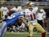 San Francisco 49ers QB Alex Smith and Lions Defensive End Kyle Vanden Bosch