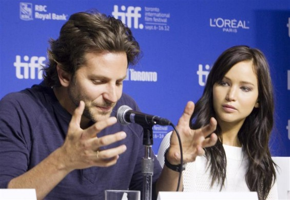 "Actors Bradley Cooper (L) and Jennifer Lawrence attend a news conference to promote the film ""Silver Linings Playbook"" during the 37th Toronto International Film Festival September 9, 2012."