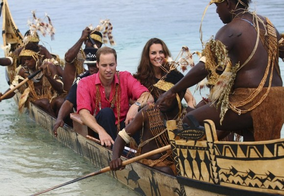 Britain's Prince William and Catherine, the Duchess of Cambridge, ride a traditional war canoe as they arrive in Tavanipupu, Solomon Islands, September 17, 2012. Prince William and Catherine, the Duch
