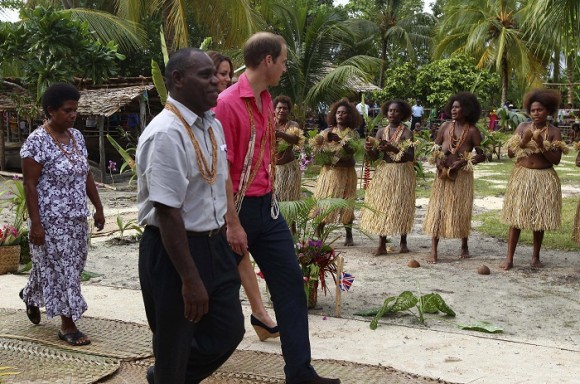 Women in traditional attire perform as Britain's Prince William and his wife Catherine, the Duchess of Cambridge, arrive at Marapa Island, Solomon Islands, September 17, 2012. Prince William and Cathe
