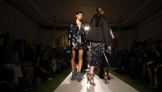 Models present creations from the Mulberry Spring/Summer 2013 collection at London Fashion Week September 18, 2012.