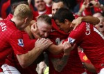 Manchester United's Buttner celebrates his goal against Wigan Athletic during their English Premier League soccer match in Manchester