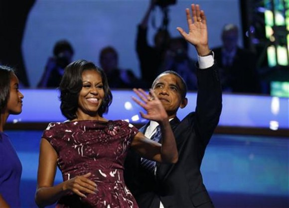 U.S. President Barack Obama celebrates with first lady Michelle Obama and his daughter Malia (L) after accepting the 2012 U.S Democratic presidential nomination during the final session of Democratic