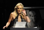 U.S. actress Sharon Stone attends an auction at a charity dinner for The Foundation for AIDS Research (amfAR) during Milan's Fashion Week September 22, 2012.