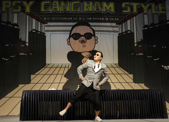 South Korean singer Psy dances after a news conference at a hotel in Seoul September 25, 2012.