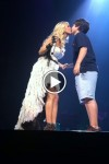 The moment Carrie Underwood kissed her 12-year-old fan Chase at a concert in Louisville, Kentucky on September 22, 2012.