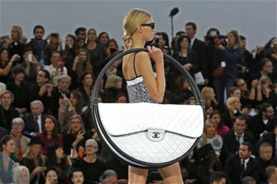 A model presents a creation by German designer Karl Lagerfeld for French fashion house Chanel as part of his Spring/Summer 2013 women's ready-to-wear fashion show during Paris fashion week October 2,