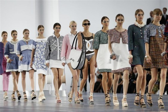 Models present creations by German designer Karl Lagerfeld for French fashion house Chanel as part of his Spring/Summer 2013 women's ready-to-wear fashion show during Paris fashion week October 2, 201
