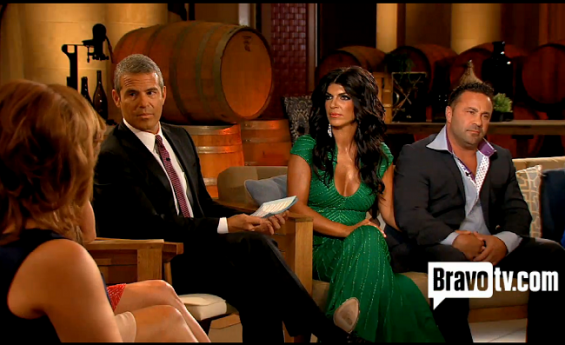 "Andy Cohen (left), Teresa Giudice (middle) and her husband Joe Giudice (right) are shocked that Jacqueline Laurita said, ""You walked in on your husband when he had somebody on the desk in his office."""