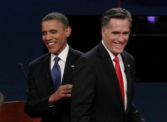 President Barack Obama (L) and Republican presidential nominee Mitt Romney share a laugh at the end of the first presidential debate in Denver October 3, 2012.