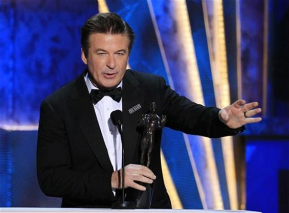 "Actor Alec Baldwin accepts the award for outstanding performance by a male actor in a comedy series for ""30 Rock"" at the 18th annual Screen Actors Guild Awards in Los Angeles, California January 29, 2"