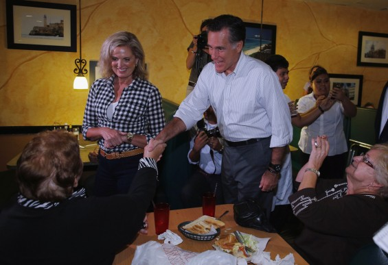Republican presidential nominee Mitt Romney and his wife Ann greet diners during a visit to La Tersesita Restaurant in Tampa, Florida October 5, 2012. 