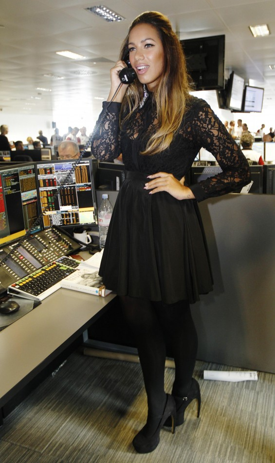 Singer Leona Lewis speaks on a telephone on the trading floor of BGC Partners, in London September 11, 2012.