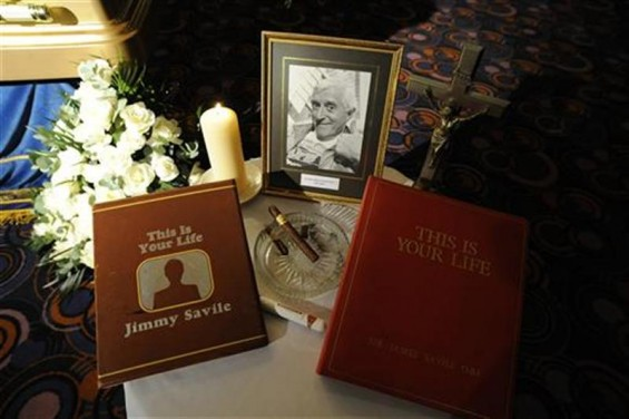 A tribute is seen next to the coffin of British entertainer Jimmy Saville as it is displayed to the public at The Queens Hotel in Leeds, northern England November 8, 2011. 