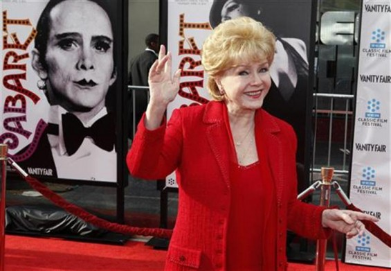 "Actress Debbie Reynolds arrives at the world premiere of the 40th anniversary restoration of the film ""Cabaret"" during the opening night gala of the 2012 TCM Classic Film Festival in Hollywood, Califo"