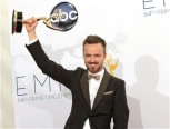 "Aaron Paul raises the Emmy award for outstanding supporting actor for a drama series for his role in ""Breaking Bad"" at the 64th Primetime Emmy Awards in Los Angeles September 23, 2012."