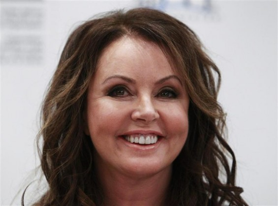 British singer Sarah Brightman smiles during a news conference in Moscow October 10, 2012.
