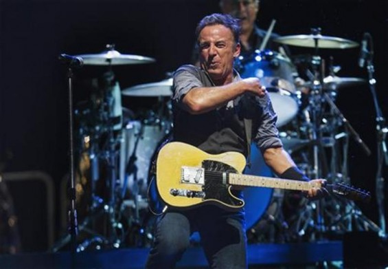 Bruce Springsteen performs with the E Street Band during a concert in East Rutherford, New Jersey, September 19, 2012.