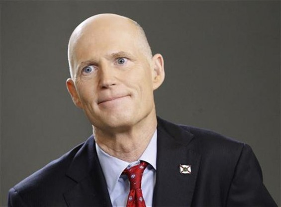 Florida Governor Rick Scott speaks during an interview in New York, March 26, 2012.