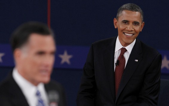 U.S. President Barack Obama (R) listens as Republican presidential nominee Mitt Romney (L) answers a question during the second presidential debate in Hempstead, New York, October 16, 2012.