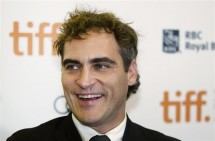 """Actor Joaquin Phoenix arrives on the red carpet for the gala presentation of the film """"The Master"""" at the 37th Toronto International Film Festival, September 7, 2012."""