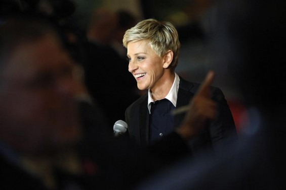 Ellen DeGeneres smiles as she talks to a reporter while arriving for the Mark Twain Prize ceremony in Washington, October 22, 2012.