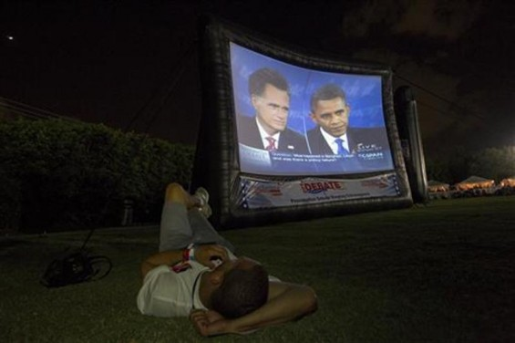 A member of the crowd watches Republican presidential nominee Mitt Romney and U.S. President Barack Obama meet in the final U.S. presidential debate in Boca Raton, Florida, October 22, 2012.