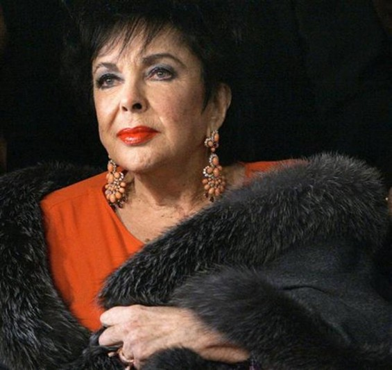 Elizabeth Taylor arrives for a play in Los Angeles in this December 1, 2007 file photo.