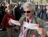 A Rolling Stones fan displays two tickets he purchased for a short warm-up gig in Paris October 25, 2012 as the group prepares for a series of 50th anniversary concerts later this year. 