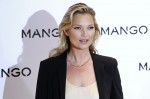 British model Kate Moss poses during the launch of the new Mango 2012 collection in London January 24, 2012.