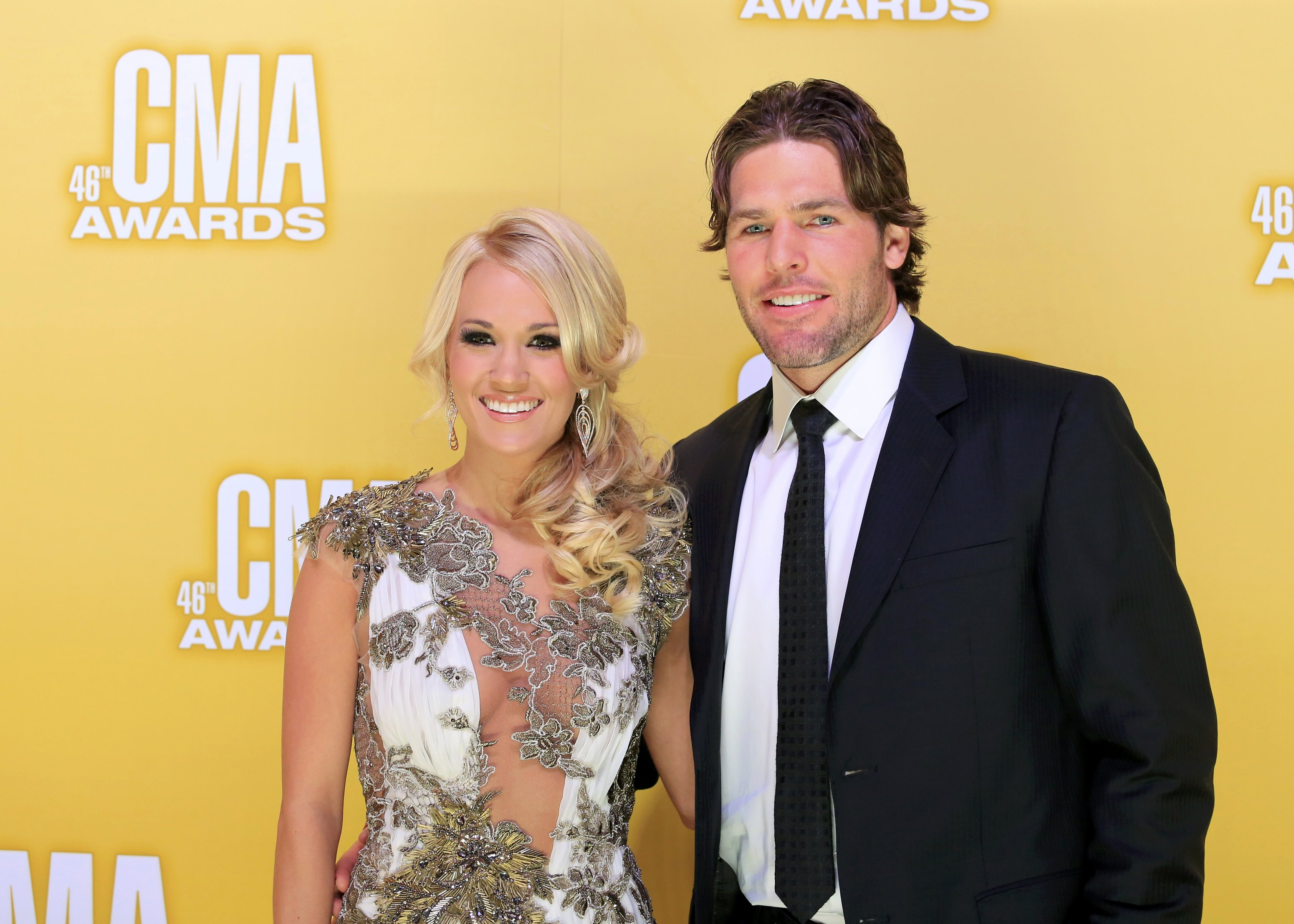 Singer Carrie Underwood and her husband, NHL hockey player Mike Fisher, arrive at the 46th Country Music Association Awards in Nashville, Tenn. (Nov.
