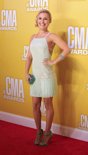 Actress Hayden Panettiere poses as she arrives at the 46th Country Music Association Awards in Nashville, Tennessee, November 1, 2012.
