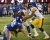 New York Giants running back Andre Brown (35) runs into fullback Henry Hynoski (45) trying to block for him as Pittsburgh Steelers free safety Ryan Clark (25) and cornerback Ike Taylor (24) tackle him