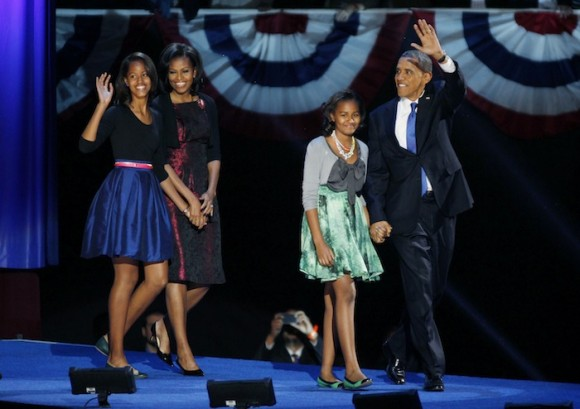 U.S. President Barack Obama walks out with his family to address supporters during his election night rally in Chicago