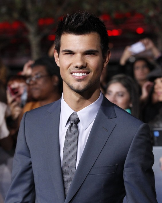 "Cast member Taylor Lautner poses at the premiere of ""The Twilight Saga: Breaking Dawn - Part 2"" in Los Angeles, California, November 12, 2012. The movie opens in the U.S. on November 16."