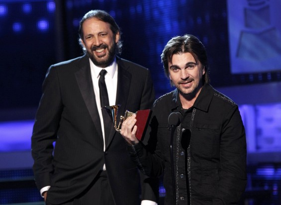 "Juanes accepts the award for album of the year for ""MTV Unplugged"" with producer Juan Luis Guerra (L) during the 13th Latin Grammy Awards in Las Vegas, Nevada, November 15, 2012."