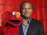 Voice actor Kevin Clash arrives with the puppet Elmo for the 2010 Peabody Award ceremony at the Waldorf Astoria in New York in this May 17, 2010 file photo.