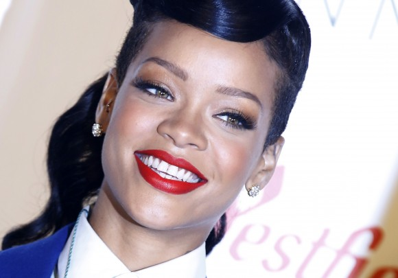 Singer Rihanna poses before an appearance to switch on the Christmas lights at Westfield shopping centre in Stratford, east London November 19, 2012.