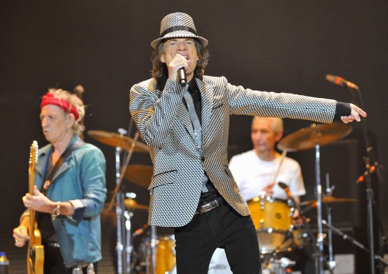 Mick Jagger (C), Keith Richards (L) and Charlie Watts (R) perform with the Rolling Stones at the O2 Arena in London November 25, 2012. The Stones took to the stage on Sunday after a five-year hiatus t