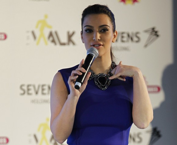 U.S. television celebrity Kim Kardashian performs during a promotional visit to a newly built shopping mall in Riffa, south of Manama December 1, 2012.