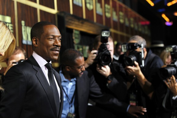 "Actor Eddie Murphy (L) poses as he arrives for the taping of the Spike TV special tribute ""Eddie Murphy: One Night Only"" at the Saban theatre in Beverly Hills, California November 3, 2012. The program"