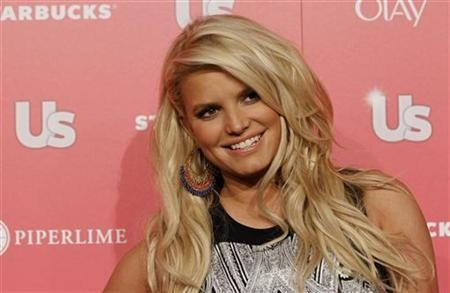 Actress and honoree Jessica Simpson poses at the US Weekly Hot Hollywood Style issue party in Hollywood, California, April 26, 2011