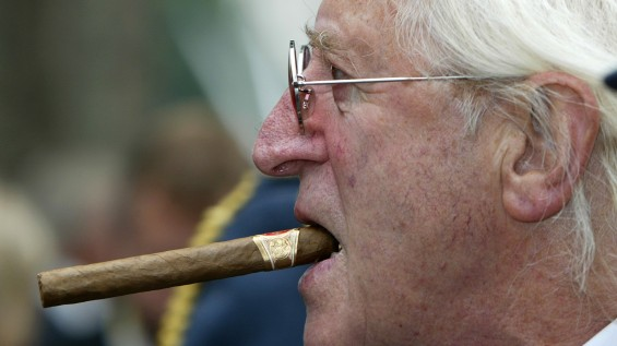 Disgraced British entertainer Jimmy Savile is seen arriving at the unveiling of a new monument, commemorating the fighter pilots who fought in the Battle of Britain, in London in this September 18, 20