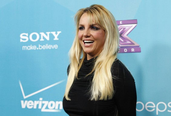 Judge Britney Spears poses at the party for the television series &#034;The X Factor&#034; finalists in Los Angeles, California November 5, 2012. 