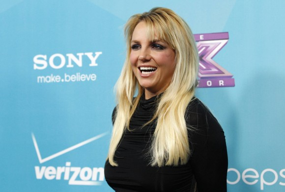 "Judge Britney Spears poses at the party for the television series ""The X Factor"" finalists in Los Angeles, California November 5, 2012."