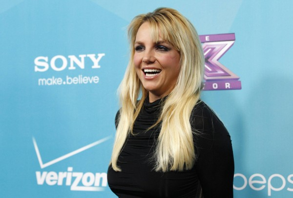 Judge Britney Spears poses at the party for the television