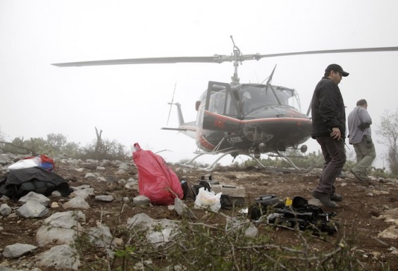 Forensic personnel inspect area of crash site of plane with Mexican-American singer Jenni Rivera on board, in Iturbide