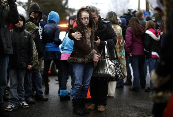 Children at a memorial close to Sandy Hook Elementary School for victims of the shooting on Dec. 14