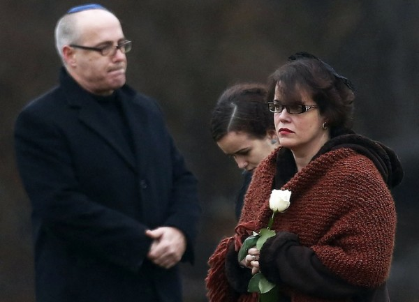 Veronique Pozner, mother of Sandy Hook Elementary school shootings victim Noah Pozner, walks to his gravesite for his burial at B'nai Israel Cemetery in Monroe, Connecticut