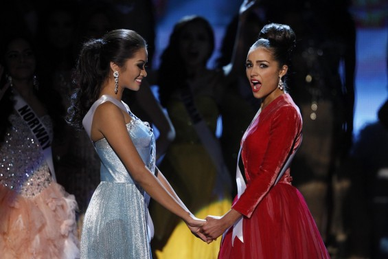 Miss USA Olivia Culpo (R) reacts with Miss Philippines Janine Tugonon after winning the Miss Universe pageant at Planet Hollywood Resort and Casino in Las Vegas, Nevada December 19, 2012. Tugonon is t